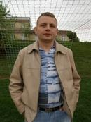 Mariusz KUD�A